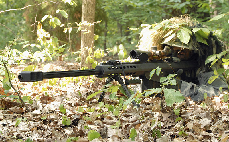 army sniper camouflaged in forest