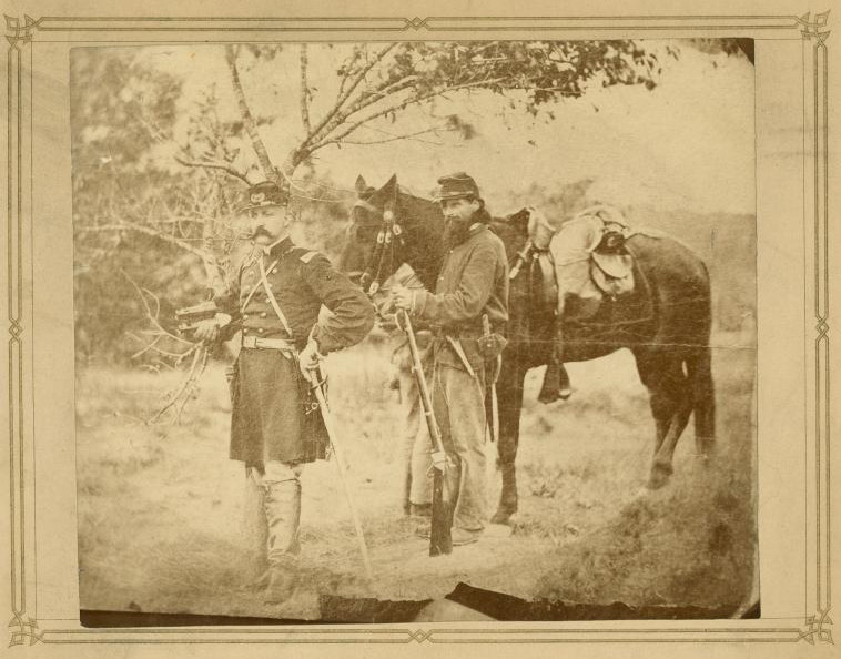 Hiram Berdan and Truman Head standing by horse